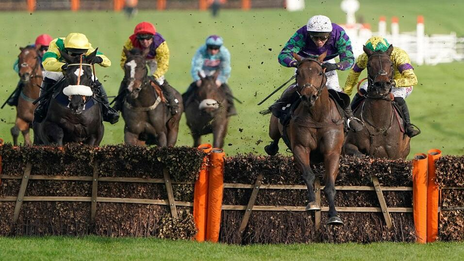 Runners take a fence at the Cheltenham Festival