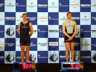 Stroke-seats Constantine Louloudis of Oxford and Henry Hoffstot of Cambridge weigh-in