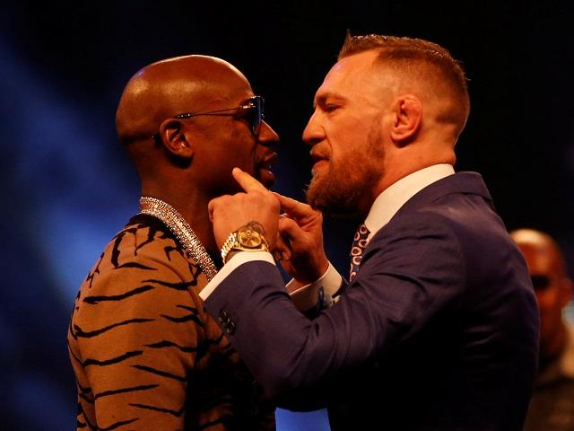 Mayweather (left) is firm favourite to beat McGregor