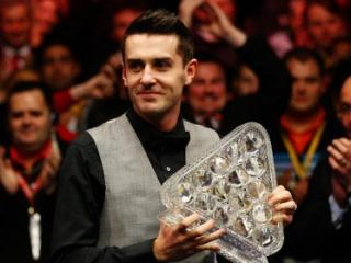 Mark Selby remains on course to defend his Masters title