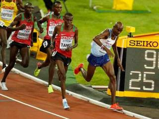 Tough guy - Mo Farah is tripped but keeps going on his way to gold