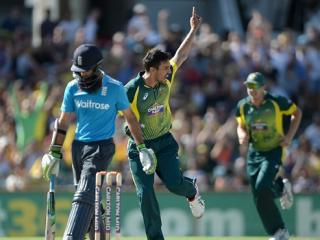 Health warning...Mitchell Johnson celebrates bouncing out Moeen Ali
