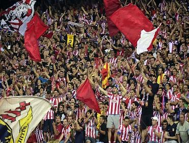 Atletico fans celebrate their Supercopa win