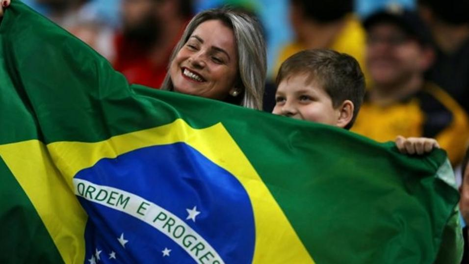 Brazilian football fans with flag