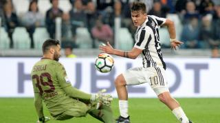Juventus forward Paulo Dybala and Torino goalkeeper Salvatore Sirigu