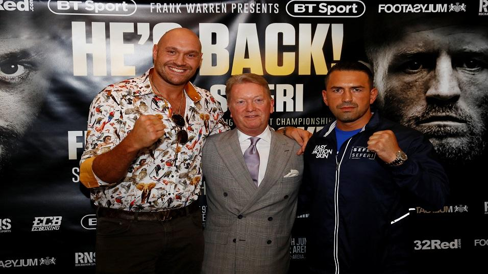Tyson Fury (left) poses with Sefer Seferi (right) and promoter Frank Warren