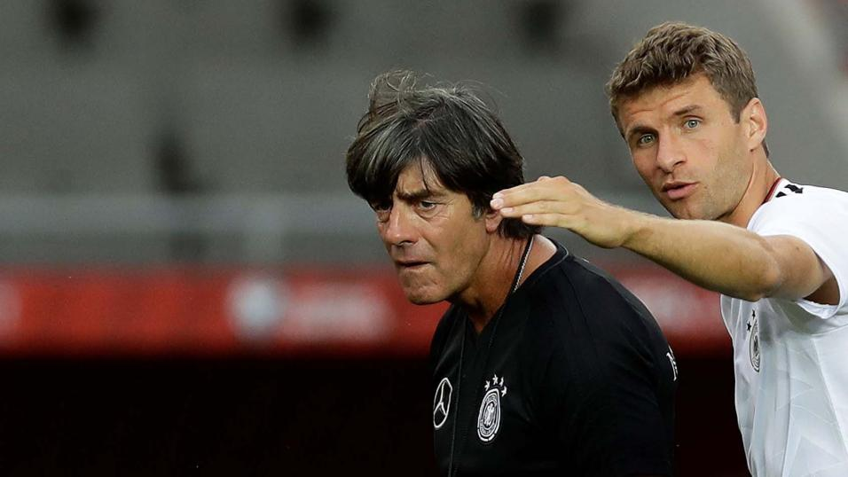 Jogi Low and Thomas Mueller