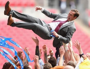 Justin Edinburgh and his squad have been flying high this season