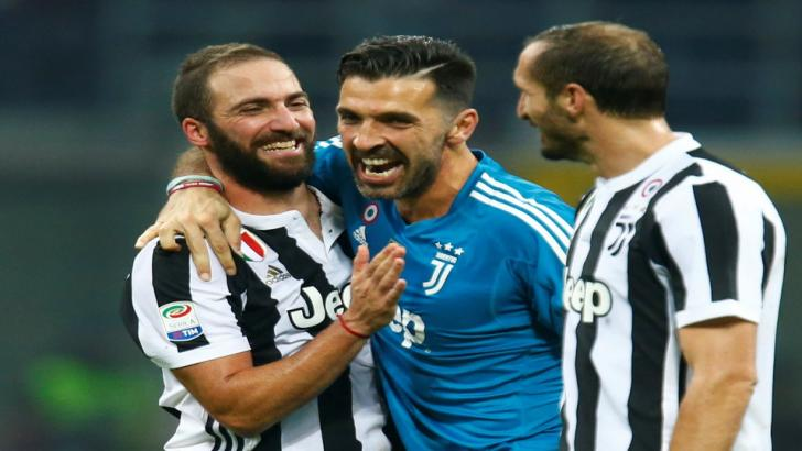 Gonzalo Higuaín celebrates Saturday's win at Milan with Gigi Buffon and Giorgio Chiellini