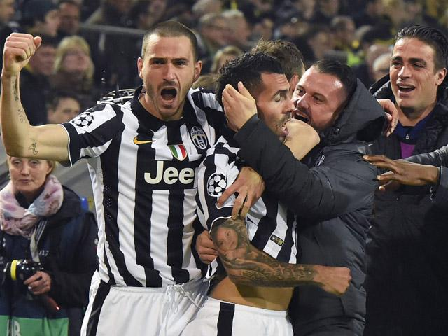 Carlos Tevez was vigorously congratulated in the previous round