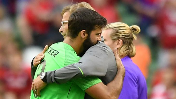 Liverpool manager Jurgen Klopp with goalkeeper Allison Becker.