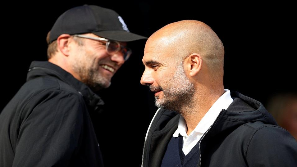 Jurgen Klopp (left) and Pep Guardiola share  joke