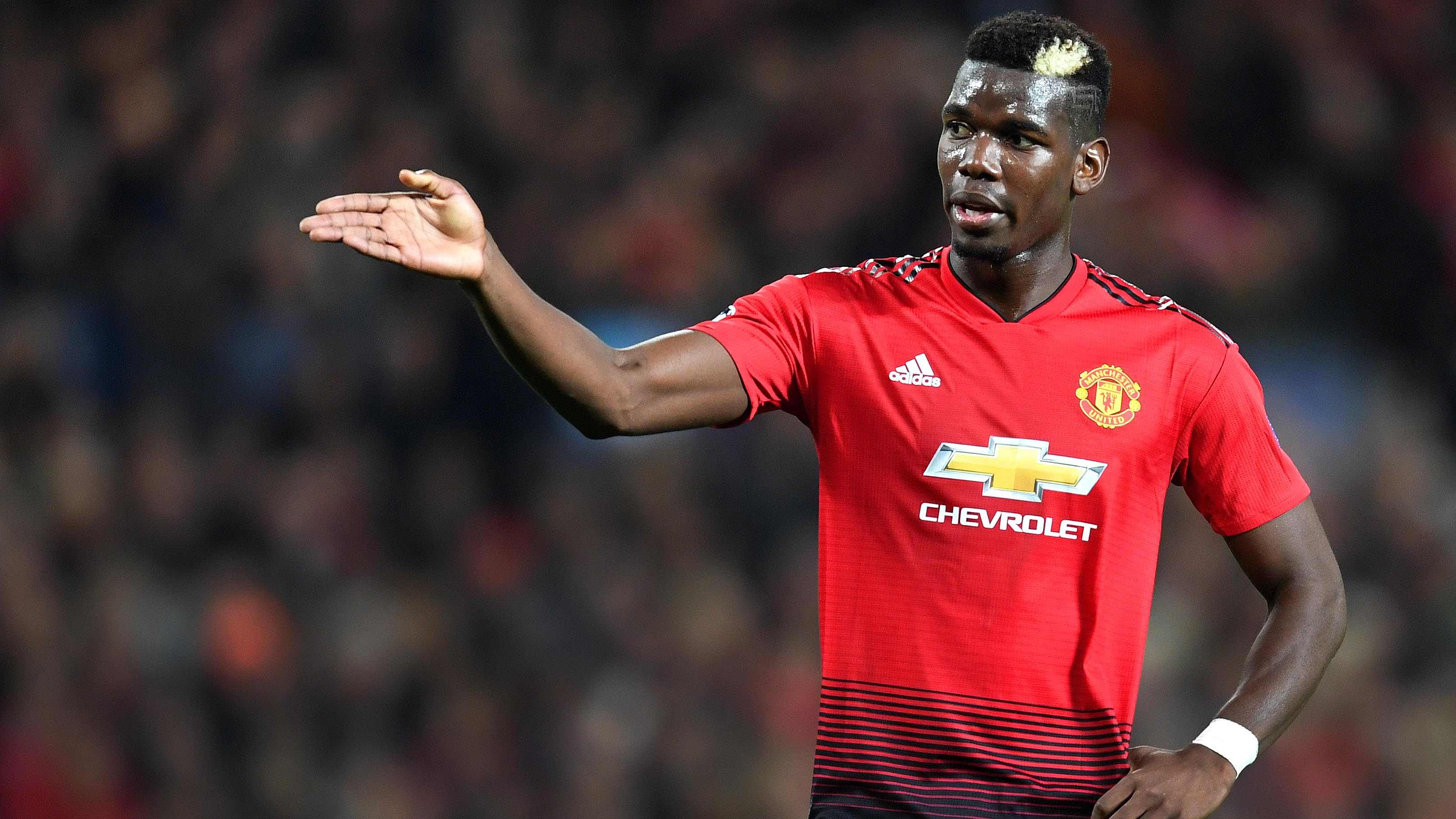 Paul Pogba hand on hip arm outstretched 1280.jpg
