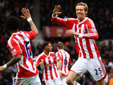 Peter Crouch looks determined to make the most of his surprise run in the side