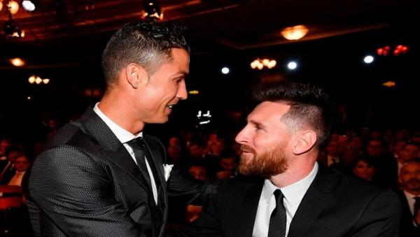 Ronaldo and Messi suited 956.jpg