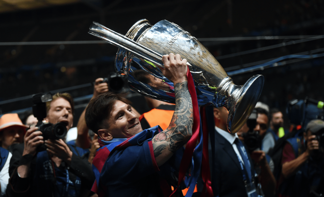 Lionel Messi with the Champions League trophy