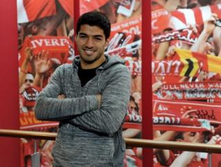 Smiling assassin: Suarez to lead Liverpool to cup glory