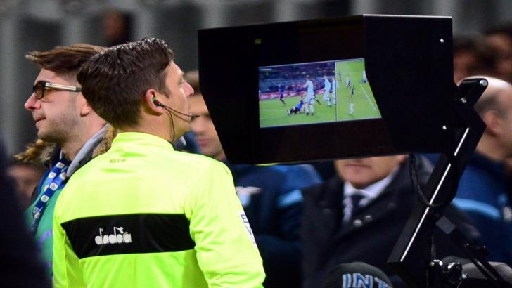 A referee consults the VAR system
