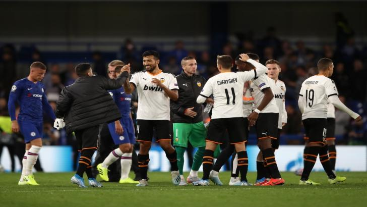 Valencia celebrate their win at Chelsea