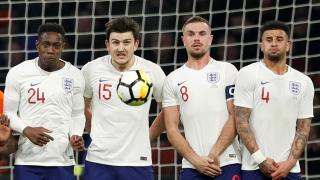 England players in a wall