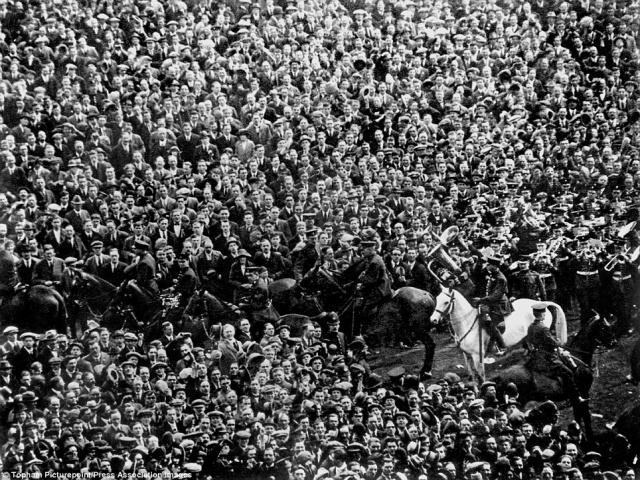 Mounted police keep an excess of 300,000 fans from spilling onto the Wembley pitch, including constable George Scorey and his white horse Billy