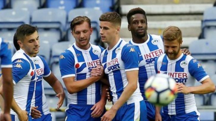 Wigan Athletic players celebrate