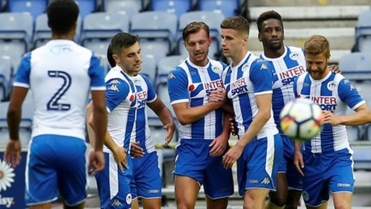 Wigan Athletic are four points clear at the top of the League One table