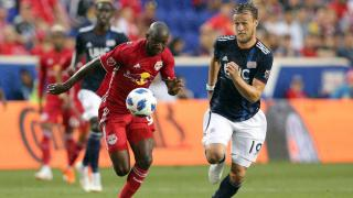 New York Red Bulls forward Bradley Wright Phillips and Antonio Delamea Milnar of New England Revolution