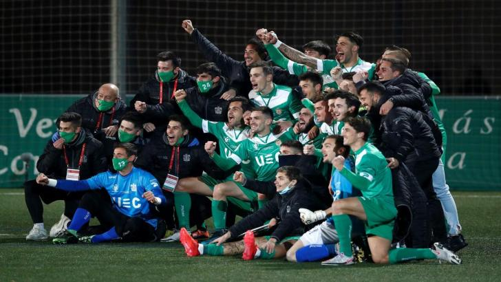 Cornella players celebrate after beating Atletico Madrid