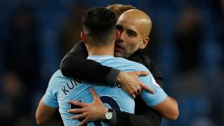 Manchester City manager Pep Guardiola hugging Sergio Aguero.