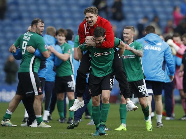 Lincoln City players celebrate after their shock FA Cup win over Burnley