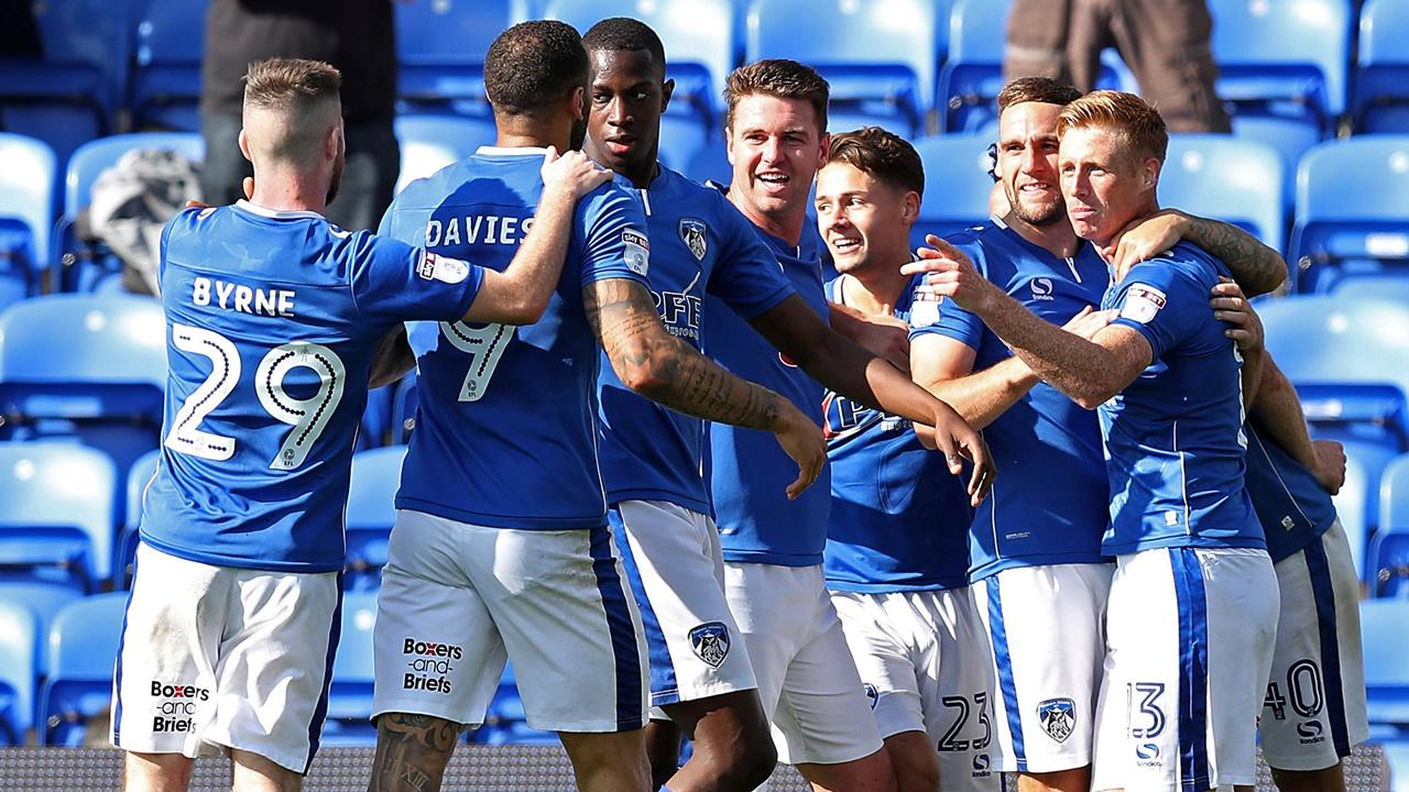 Oldham Athletic players celebrate
