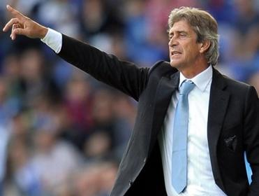 Manuel Pellegrini points the way to goal