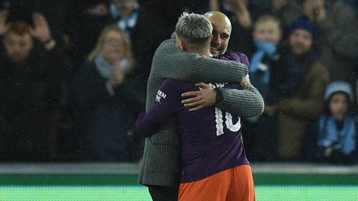 Manchester City manager Pep Guardiola with Sergio Aguero.