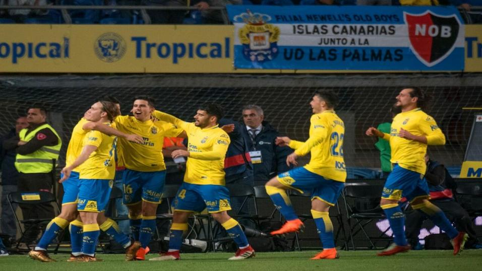 Las Palmas players celebrate a goal
