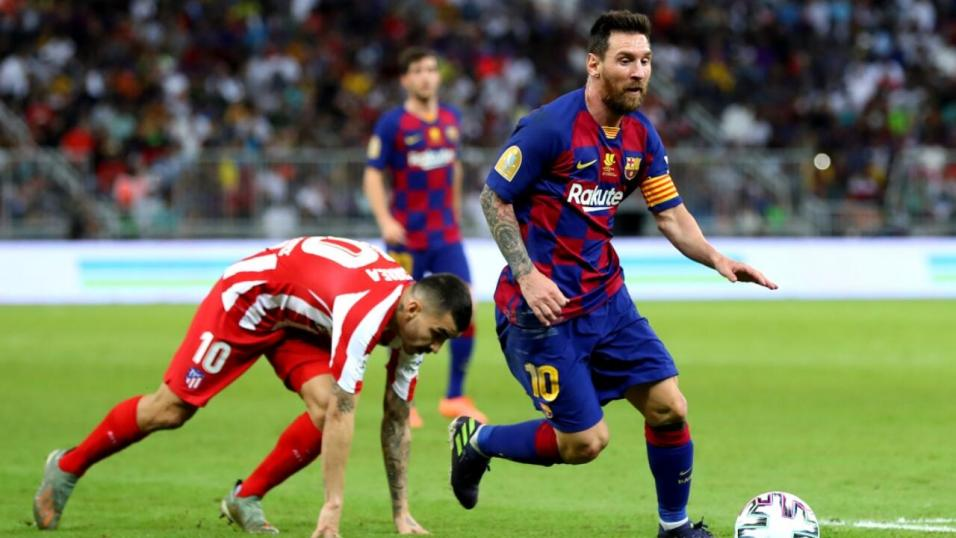 Lionel Messi playing for Barcelona against Atletico Madrid
