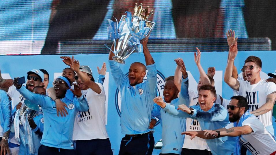 Man City players celebrate winning the Premier League.
