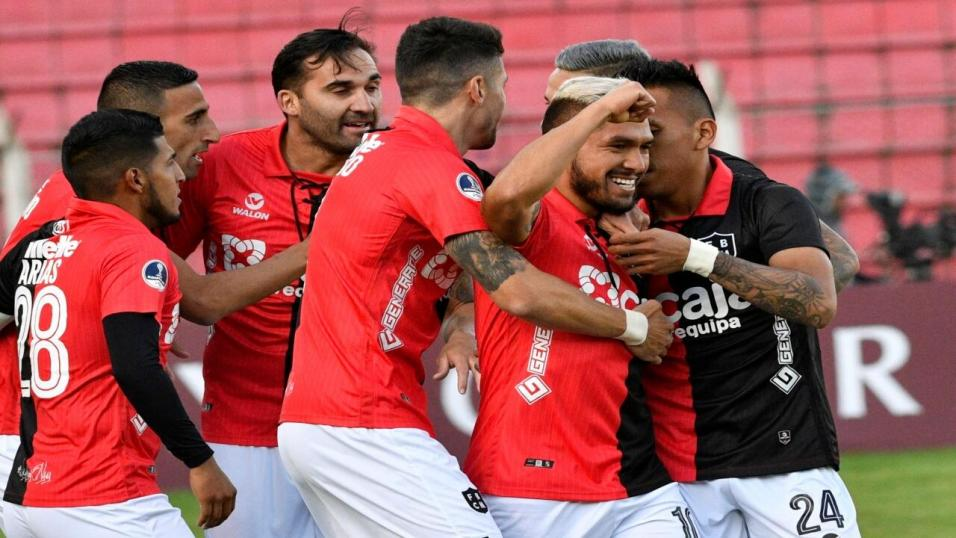 Melgar players celebrate a goal