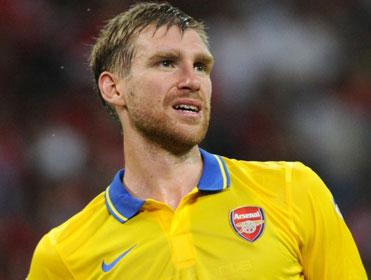 Arsenal's German defender Per Mertesacker will be kept busy