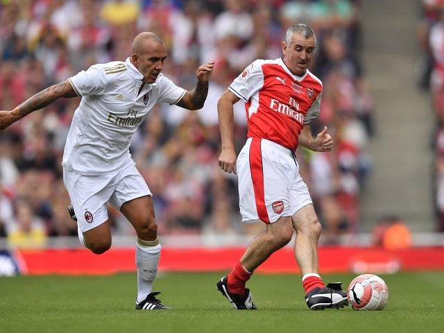 Still got it - Nigel Winterburn shakes off Paolo di Canio in a recent Arsenal Legends match
