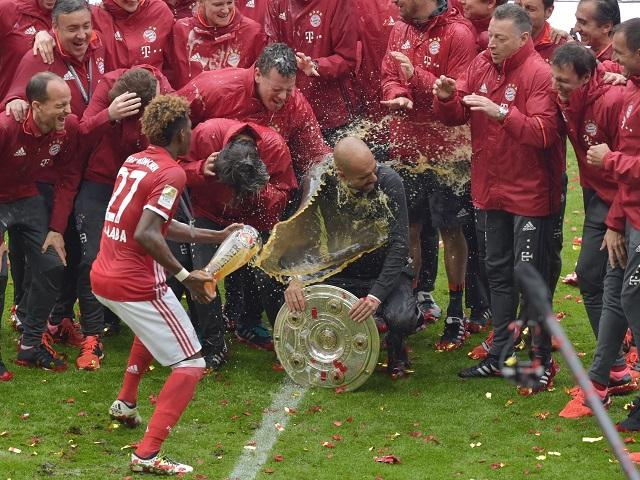 Pep Guardiola is soaked as Bayern Munich celebrate their Bundesliga title