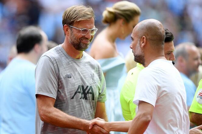 Liverpool manager Jurgen Klopp and Manchester City manager Pep Guardiola shake hands