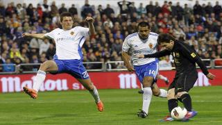 Lionel Messi takes on Real Zaragoza