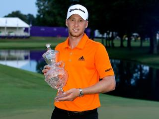 Daniel Berger with the FedEx St. Jude Classic trophy