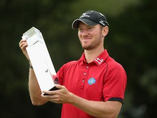 A happy Chris Wood with the BMW PGA Championship trophy