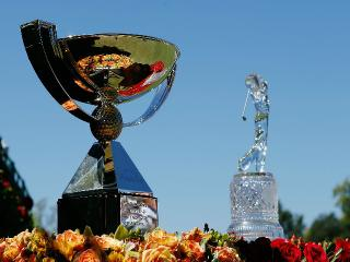 Who will capture the FedEx Cup and Tour Championship trophies?