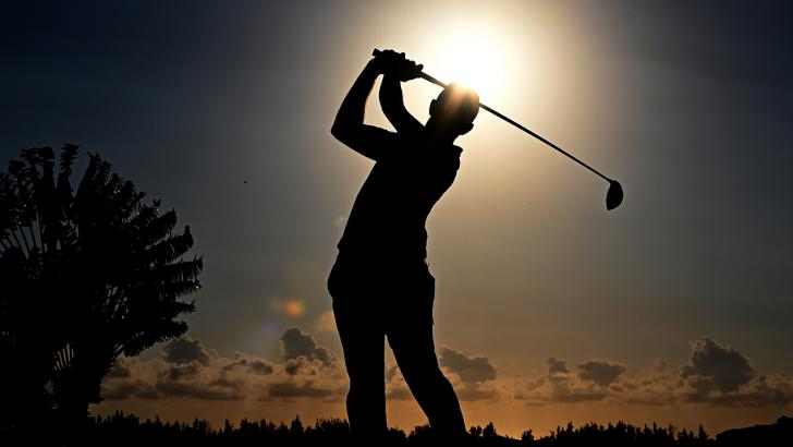 Golfer teeing off silhouette