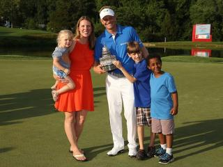 The Hurley family with the Quicken Loans trophy