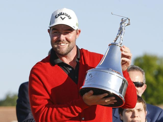 Winner, Marc Leishman, wearing the new traditional red cardigan