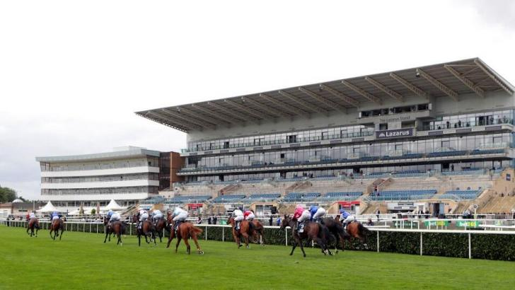Doncaster racecourse stand and runners